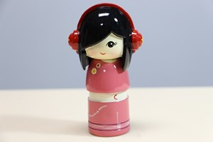 Picture of Decorative Countertop Doll - Girl w. Headphones
